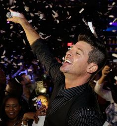 Robin Thicke hosts New Year's Eve inside SLS Las Vegas on Dec 31, 2014 (Photo credit: Isaac Brekken/Getty Images).