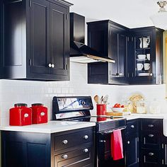 love the cleaness of the subway white tile and the style of these cabinets. not sure about the color & red pops