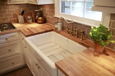 Nate Berkus creates a warm space with butcher block, a farmhouse sink, and LG Studio appliances: www.LGStudioKitchen.com