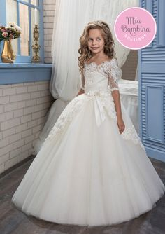 This super elegant Buffalo dress with half-length lace sleeves and scalloped lace edge neckline is the perfect flower girl dress for a wedding day. Beautiful floor length full skirt from the finest tu