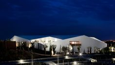 PROMONTORIO Architects together with Marcio Kogans's StudioMK27 have designed the  L'AND Vineyards Resort in Montemor, Portugal