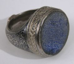 Seal Ring with the name of Hajji Muhammad ibn Mahmud, probably 16th c, Central Asia or Iran. Bezel: lapis-lazuli; carved Shank: silver; worked, gilded, and with black inlay. The Metropolitan Museum of Art, New York. Bequest of W. Gedney Beatty, 1941 (41.160.280). #jewelry #ring