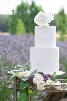 All-white wedding cake topped with an intricate sugar flower All White Wedding, White Wedding Cakes, Wedding Desserts, Wedding Cupcakes, Wedding Cake Toppers, Lace Wedding, White Cakes, Purple Wedding, Wedding Bells