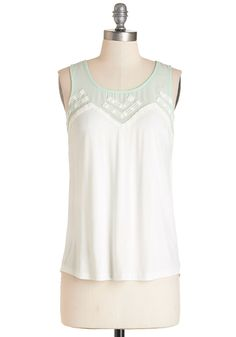 Fun-Loving Friday Top. $34.99 -   Sheer ivory loose fitting tank with mint floral embroidered neckline.