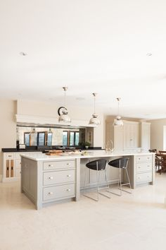 Large kitchen island, hand-painted with polished nickel hardware by Humphrey Munson. Seating by Vincent Sheppard.