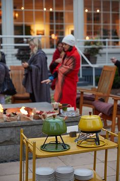 Because of the afternoon heat, it's a good idea to start the festivities later in the evening. Prepare for nightfall with blankets, string lights, candles, and perhaps even a fire pit. This evening gathering from Say Yes even had fondue stations for warm, chocolaty snacks.                   Source: Say Yes