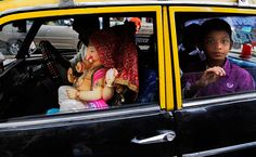 An idol of Ganesha rides in the front seat of a taxi in Mumbai on Sept. 9, 2013. The ten-day long Ganesh festival began Monday and ends with the immersion of Ganesha idols in water bodies on the 10th day.  [Credit : Rafiq Maqbool/AP]