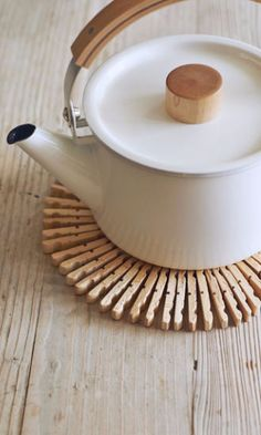 Whip up a Scandinavian-style table protector from — get this — wooden clothespins and floral wire.