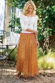 """Sun-tinted florals warm up to crinkle chiffon, layering this maxi skirt in border patterns inspired by fine market textiles. Crochet detail at the pull-on waist evokes a handmade feel; long pleats tailor the fit. Polyester; cotton/silk voile lining. Misses 38"""" long.Sits at natural waist. Spicemarket Skirt #2AG65"""