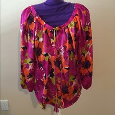 Brand new NWOT Dressy top This is a beautiful brand new top never washed it worn.  Received as a gift - wrong size.  It has gentle elastic at the cuffs and keyhole neckline with ties.  Hangs loosely and drapes beautifully. 97 % poly and 3% spandex. Josephine Studio Tops Blouses