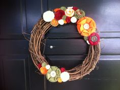 Grape vine fall wreath with felt flowers with buttons and rosettes via Etsy