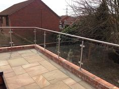 Core drill and grout fixed Diomet glass balustrade system to patio area.