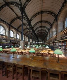 "(1/3) Ste Geneviève Library - (1844-1850) Paris (4 photos) «Between 1838 and 1850, the current Sainte-Geneviève Library was designed and constructed under the direction of the architect Henri Labrouste. The glass and iron reading room has been described as ""magisterial"", making the building a seminal work in the creation of the modern library as ""a temple of knowledge and space for contemplation"". Photos : Romain CR"