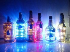 Transform empty alcohol bottles into cutesy lamps that look very smart, playful and brighten up a corner of your house.  Here's how ...