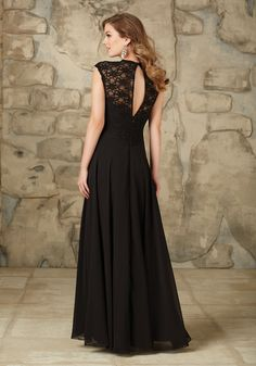 Bridesmaid Dress made from Lace and Chiffon with Cap Sleeves Designed by Madeline Gardner. Keyhole Zipper Back. Shown in Black.