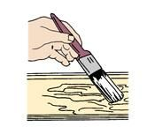 Spread the remover thickly and evenly with a paint brush.