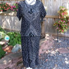 NEW ARRIVAL MISSES Sparkly black beaded and sequence dress with top overlay. Short sleeves and brilliant sequence & beaded design on front of dress. Dress is 42' long from shoulders to hemline. Sequence and beads are in great condition. Pure Silk Rayon lining. Royal Feelings Dresses