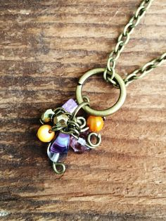 A personal favorite from my Etsy shop https://www.etsy.com/listing/237860353/upcycled-charm-necklace-purplegoldand