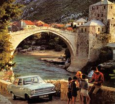 1970 Opel Kadett at the Mostar bridge 1970 Opel calender - Mostar, Bosnia-Hercegovina  Sad to see this photo. I always likes it as a kid, and years later it was headline news all over the world, when it fell victim to the hostilities between the Croat and Bosnian people living there, no matter that it is a UNESCO world heritage site. It is rebuilt now, but still literally divides the people there.