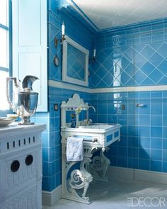 An All-Over-Tile Bathroom: Tiles by Original Style and a 19th-century painted wrought-iron washbasin in this Bordeaux, France.