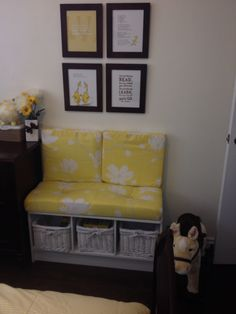 Dr Seuss pages and bench seat in child's room. Yellow white and brown scheme.