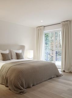 serene taupe and white contemporary bedroom