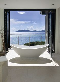 Sea view bathroom with cool contemporary-tropical style [Design: Lee H. Skolnick…