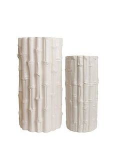 White Ceramic Bamboo Vases (HIgh Street Market) http://www.highstreetmarket.com/collections/home-decor/products/white-ceramic-bamboo-vases
