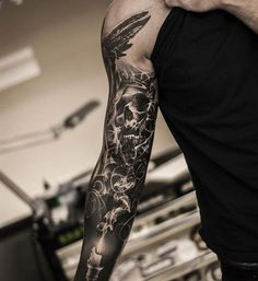 This dark imagery comes to you courtesy of Oscar Akermo.#inked #tattoo #skull #skulls #sleeve #arm #idea #blackandgrey #realism