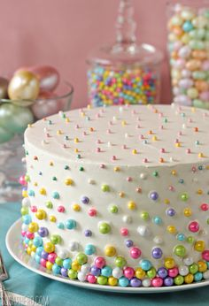 "Layer cake with pastel candy ""dots."""