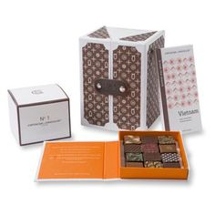 Artisan du Chocolat monogram gift boxes - A selection of chocolates, liquid salted caramels, bars and fruits  nuts in luxurious gift boxes inspired by old fashioned 'steamer trunk' luggage.