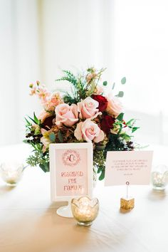 Blush, red and gold centerpieces were perfect against our gold lamour linens. | Photo by Jennifer Oetting Photography