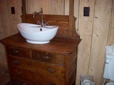 Another photo of our Antique Dresser Vessel Sink in our cabin bathroom. This is before we mounted the mirror.