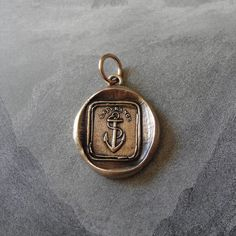 Hope - wax seal charm with anchor in bronze - antique wax seal jewelry.  via Etsy.