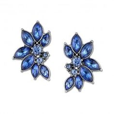 Talk about a stunner! These silver-tone earrings feature a cluster of sapphire color stones that come to life against any piece of attire.