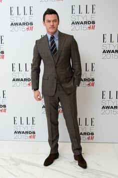 Luke Evans wearing a three-piece suit by Thom Sweeney