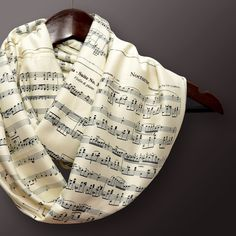 Sheet Music Infinity Scarf for all classic music admires. This scarf is very soft and cozy. You will love this scarf ! Sheet music pages on soft cream colored poly viscose fabric. This scarf featuring 10 sheet music pages from the world greatest composers : Frederic Chopin - Nocturne Schubert - Sonata in E♭ Major J.S. Bach - Minuet in G J.S. Bach - Aria - Suite No.3 in D R.Wagner - Here Comes The Bride Ludwig van Beethoven - Ode to Joy (9th Symphony) Ludwig van Beethoven - Symphony...
