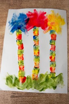 Finger painting and stamping, create a simple art work of the Lorax Trees for Dr. Seuss week!