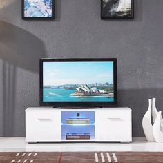 High Gloss TV Stand Unit Cabinet w/LED Shelves 2 Drawers Console Furniture White. Assemble easily. Great design & premium quality. It comes complete with 2 doors & a glass shelf, aluminum handles. Product Size: 120cm(L)*40cm(D)*38cm(H) / 47''L*16''D*15''H. It has the capability to access the devices from the rear of the stand via the built in cable management area.