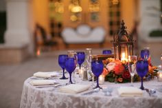 A lace tablecloth with cobalt blue glasses and lanterns will showcase a Spanish theme for your tablescape. Source: Brittrene Photography #tablescape #cobaltblue #spanishtheme
