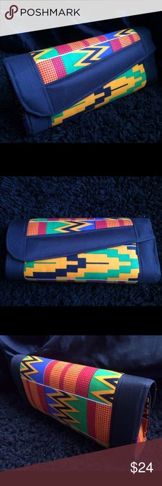 Genuine handmade Ghanaian clutch Made with authentic Ghanaian fabric. Unique vibrant colors and patterns that express the rich Ghanaian culture. Handmade in Ghana and shipped to the U.S. Big enough to fit all your essentials! These bags are one of a kind and gorgeous! Brand new, never used. Bags Clutches & Wristlets