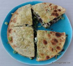 Black beans, zucchini, and a bit of cheese sandwiched between two tortillas - this may be the best quesadilla you've ever tasted.