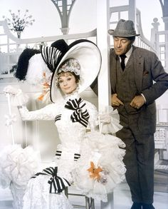 Eliza Doolittle (Audrey Hepburn) & Professor Henry Higgins (Rex Harrison) in 'My Fair Lady', 1964. Costumes designed by Cecil Beaton.