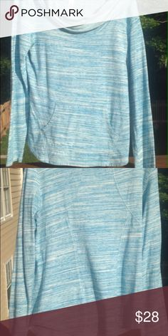 Lucy Long sleeve pullover Lucy long sleeve pullover. Large. Blue and white colors. Cowl neck. Stitching gives good shape along the back. No thumb holes. Front pocket across mid section. Good condition. Great piece for early fall exercise & errands. Lucy Tops Sweatshirts & Hoodies