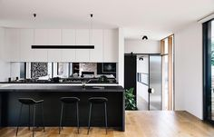 open black and white kitchen in a beach house