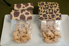 Animal crackers as favors! Cute idea and my favorite snack!