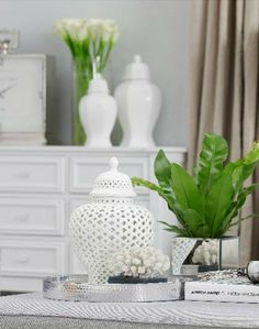 White temple jar from Hamptons Style Hamptons Living Room, Hamptons House, The Hamptons, Coastal Style, Coastal Decor, Red Feature Wall, Hamptons Style Decor, Side Table Styling, Decorating Coffee Tables