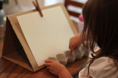 Make a paint easel from a cardboard box  and use egg carton to hold paint