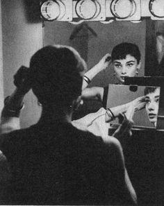 Rare Audrey Hepburn — Audrey Hepburn applying makeup in her dressing...