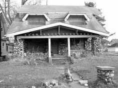 Abandoned stone Craftsman style bungalow in Highland Park, MI